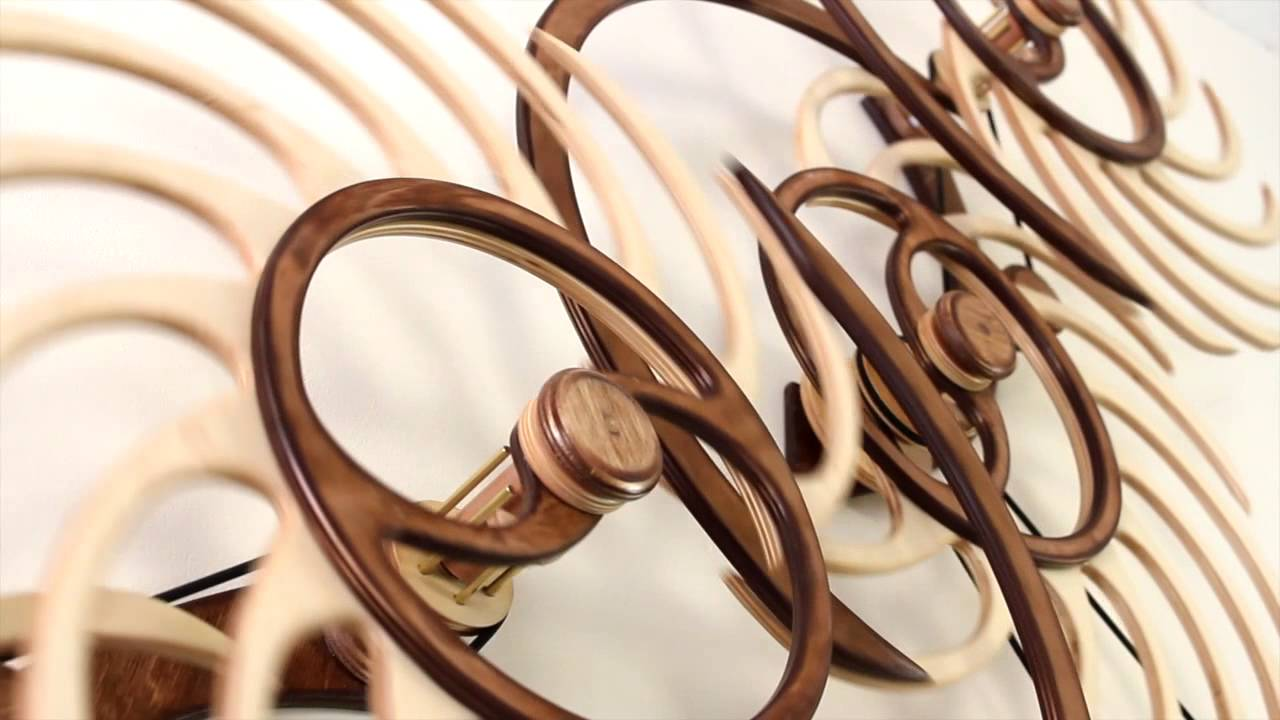 These self-propelled kinetic wood sculptures by David C. Roy can spin for nearly a day