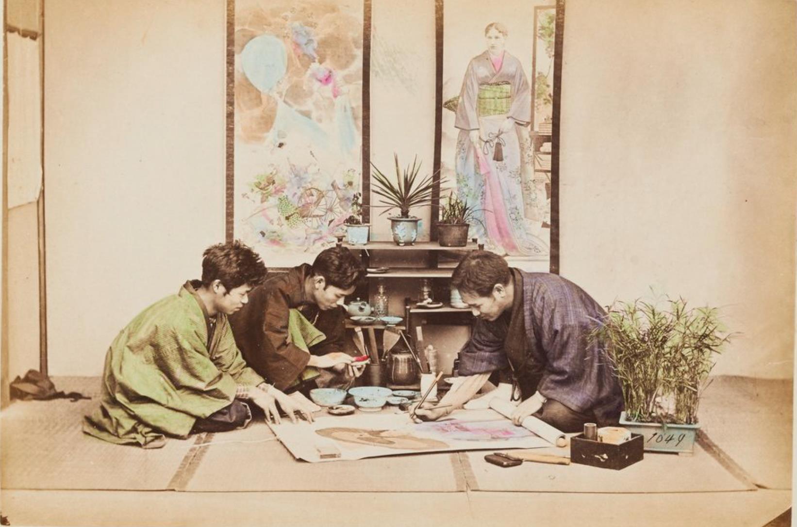 Трое мужчин за рисованием