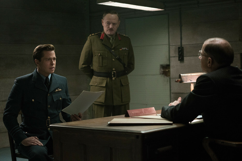 Brad Pitt plays Max Vatan, Jared Harris plays Heslop and Simon McBurney plays S.O.E. Official in Allied from Paramount Pictures.