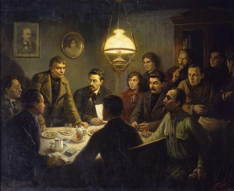 Слева направо: сидят за столом — Г.Я. Сокольников (спиной), А. Ломов (Г.И. Оппоков, в полупрофиль), М.С. Урицкий, стоит — В.И. Ленин (в гриме), сидят за столом — Я.М. Свердлов, А.М. Коллонтай, И.В. Сталин, Ф.Э. Дзержинский; стоят в правом углу— М.В. Фофанова, Л.Б. Каменев, А.С. Бубнов, Г.Е. Зиновьев, Л.Д. Троцкий.