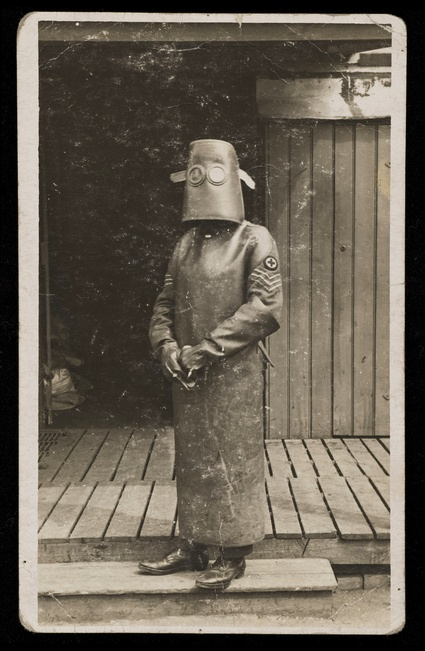 World War One, France: a radiographer wearing protective clothing and headpiece. Photograph by H. J. Hickman, ca. 1918.