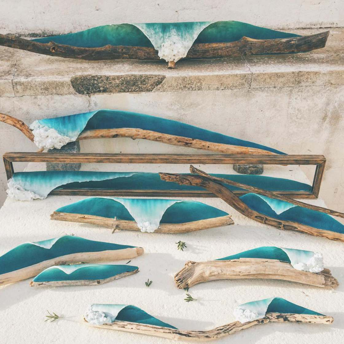 Artist sculpts waves on driftwood