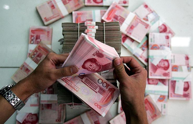 Банк Китая опустил курс юаня доминимального уровня сиюня 2008г.
