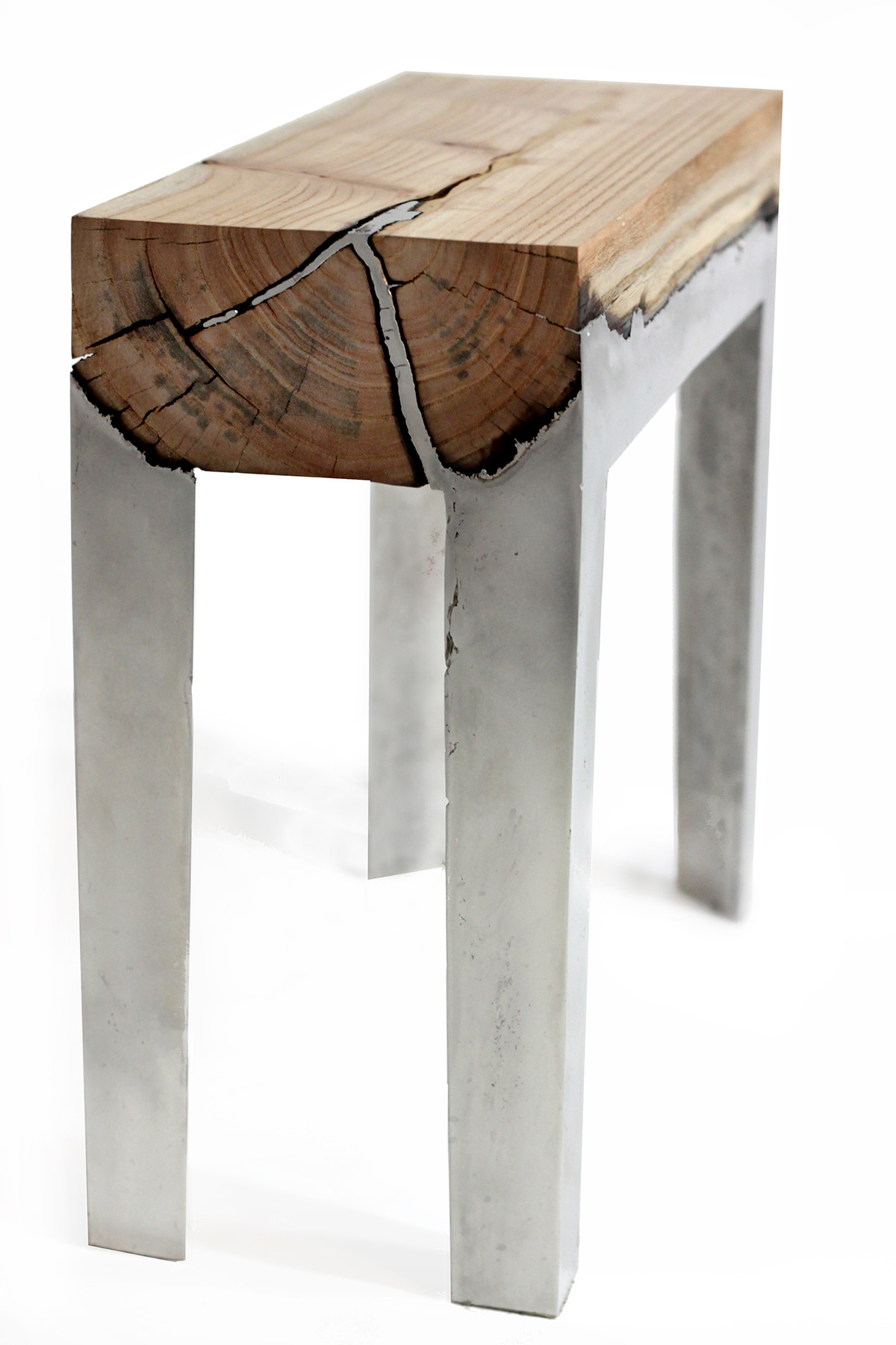 Designer Hilla Shamia Fuses Cast Aluminum and Tree Trunks to Create One-of-a-Kind Furniture Pieces