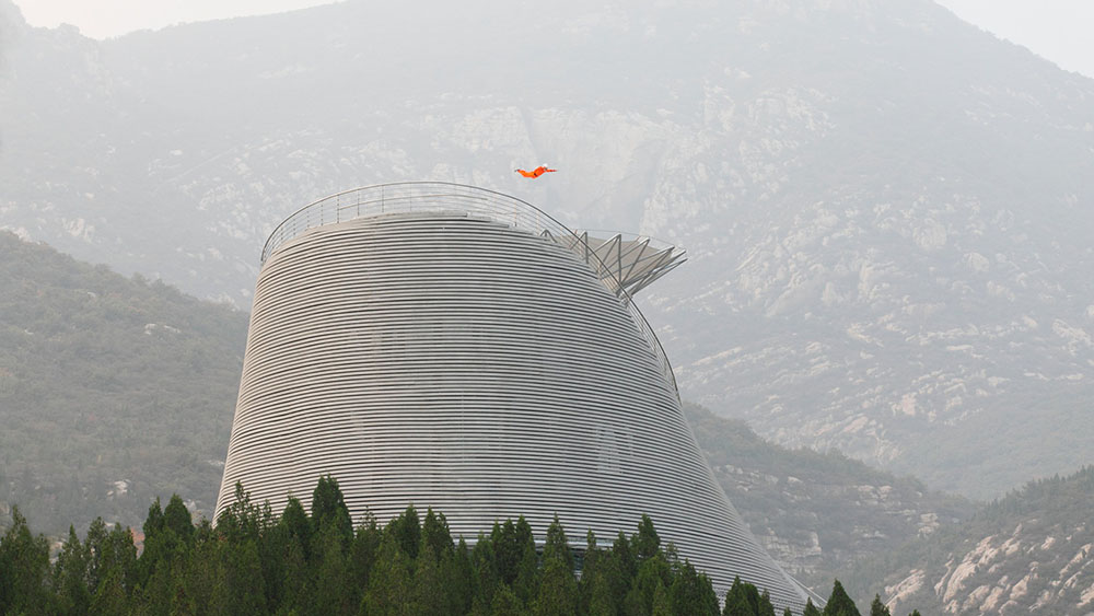 The Shaolin Flying Monks Temple Blasts Monks Into the Sky Above a Mountainside Amphitheater (7 pics)