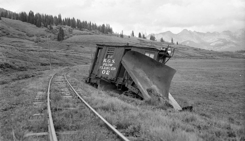 Rio Grande Southern narrow gauge snowplows, Plow-Flanger number O2, derailed. Lizard Head, Colorado, August 4, 1951.