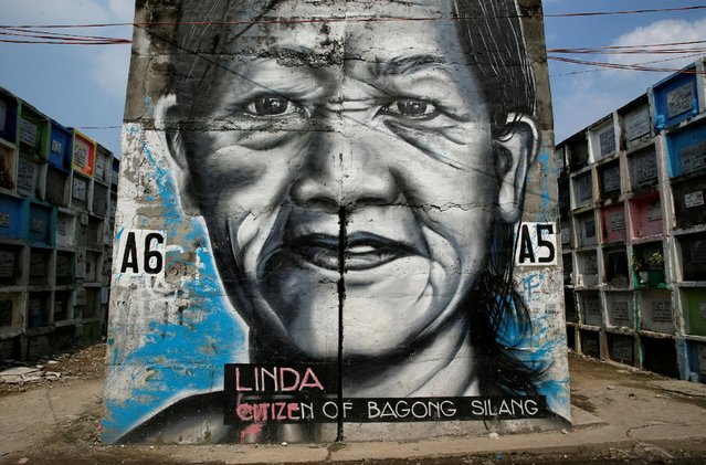 A mural of a woman is pictured at Navotas Public Cemetery, Metro Manila, in the Philippines, October