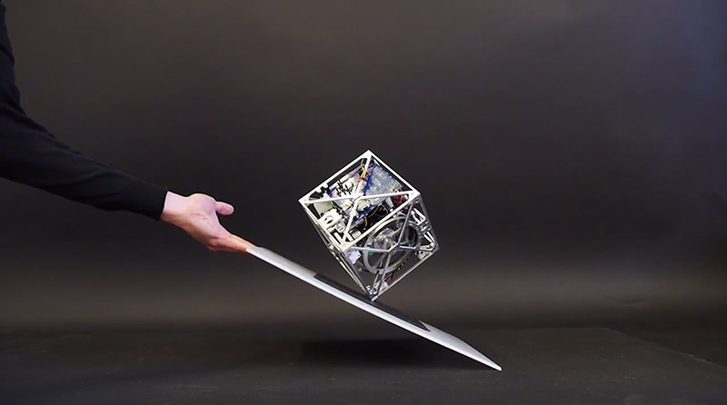 The Cubli: A Gravity-Defying Cube that Can Jump, Balance, and Walk