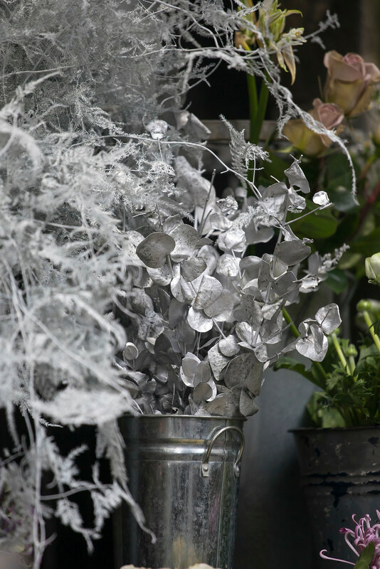 painted in silver eucalyptus leaves to bouquet
