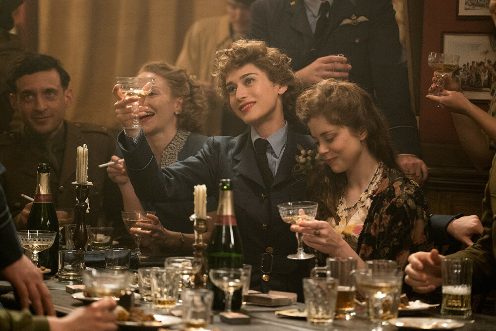 Lizzy Caplan plays Bridget Vatan and Charlotte Hope plays Louise in Allied from Paramount Pictures.
