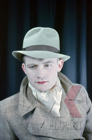 stock-photo-young-austrian-man-in-american-style-20s-hat-and-jacket-with-red-lipstick-theatre-show-1937-later-becomes-war-reporter-9021.jpg