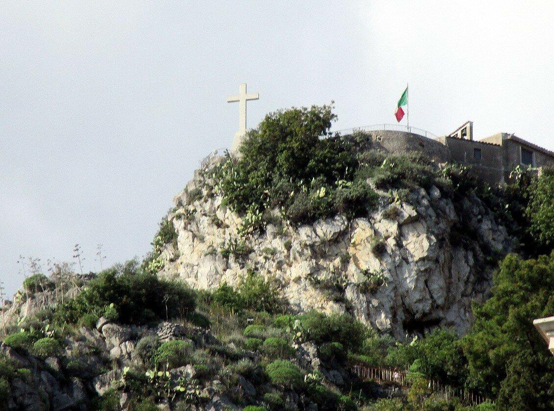 Taormina. Cross and Madonna della Roca church