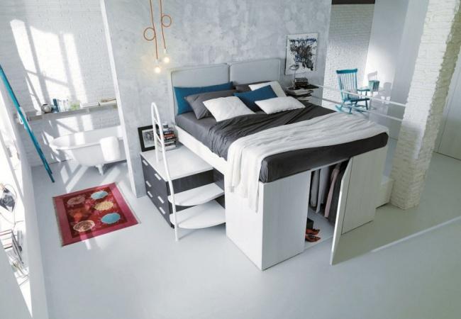 © contemporist  Подняв кровать науровень чуть выше обычного, выполучите дополнительное место