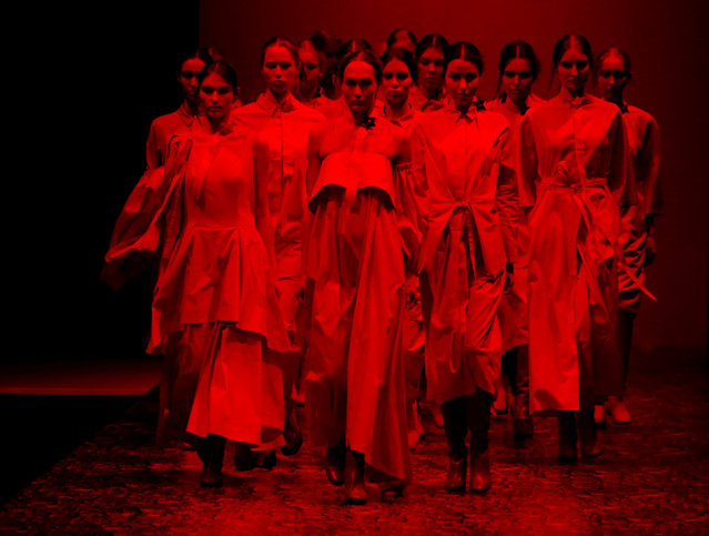 Models present creations by Russian designer Viktoria Andreyanova at the Moscow Fashion Week in Mosc