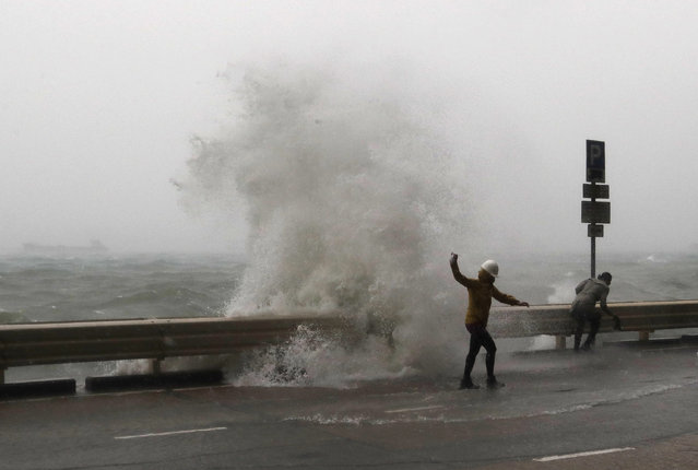 Waves crash on waterfront caused by Typhoon Haima in Hong Kong, Friday, October 21, 2016. (Photo by