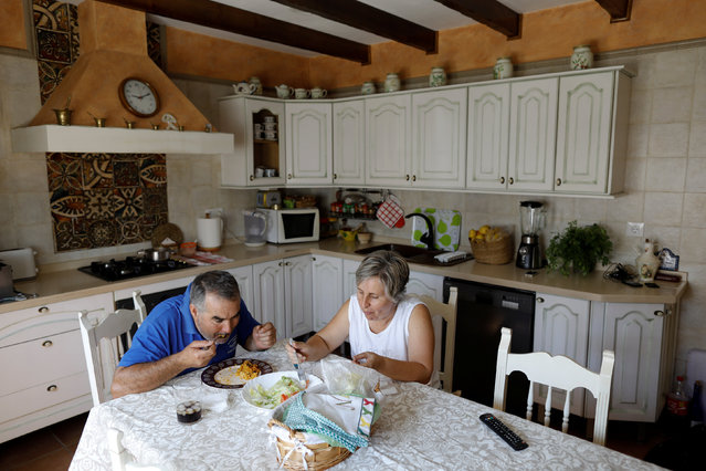 Maria Jose Manzano, 50, and her husband Joaquin Cortijo, 57, have lunch at their house in Vega de lo
