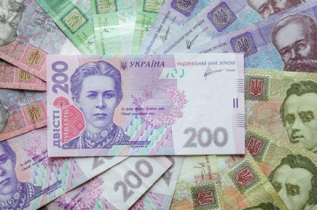 ВКабмине оценили перспективы гривни в2015-м году