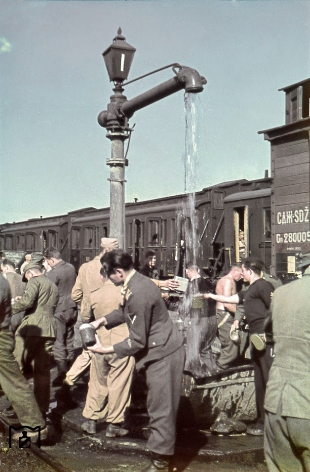 Quick refreshment during a troop transport during World War II in the Balkans.jpg