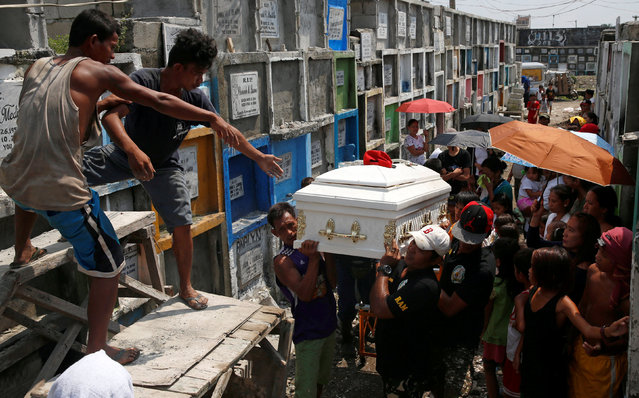 Mourners carry the coffin of Vicente Batiancila, whom police said was among five victims of drug rel