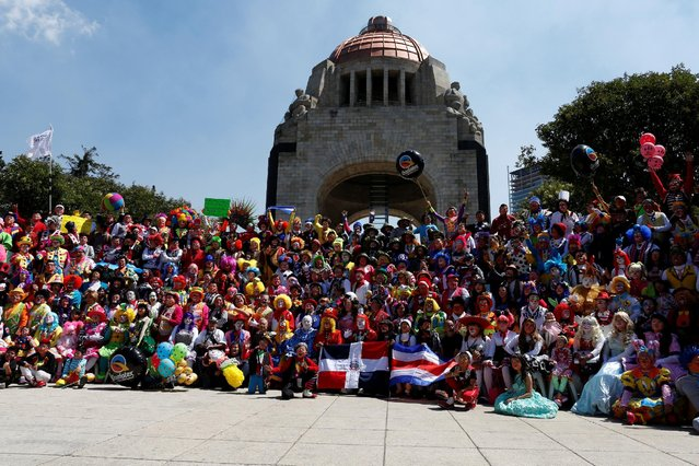 Clowns pose for the annual picture as part of the XXI Convention of Clowns, at the Monument to the R