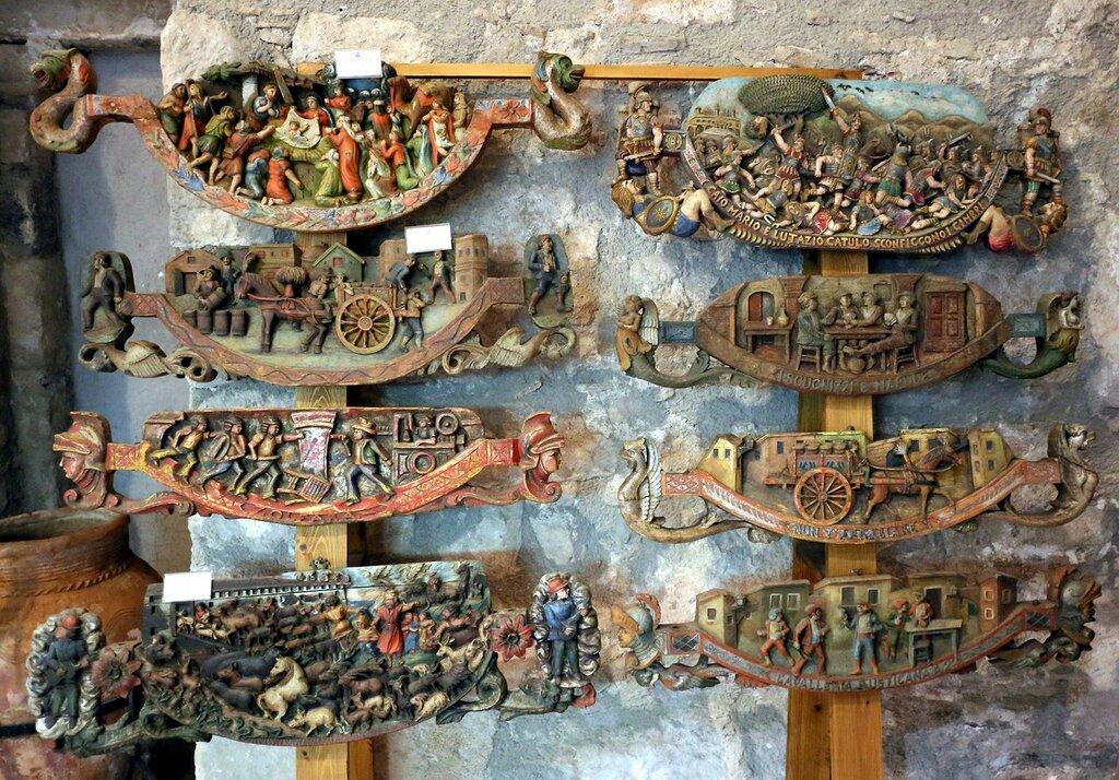 Taormina. The Museum of popular arts and traditions (Museo Siciliano di Arte e Tradizioni Popolari). A Sicilian cart. carved ornaments