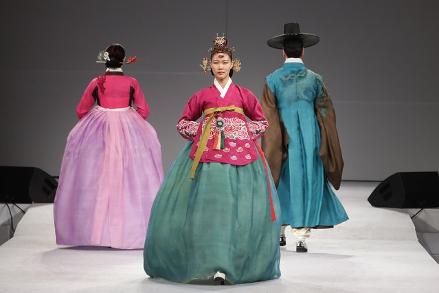 "Models walk down the catwalk during the South Korean Traditional Costume ""HanBok"" fashion show at Gy"