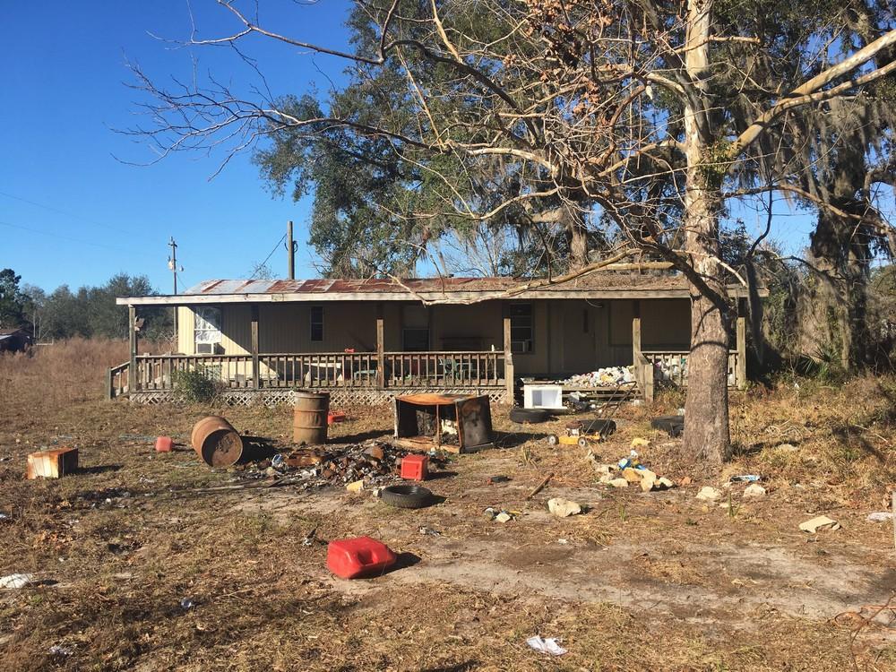 Дом, где проживала семья наркоманов с ребенком