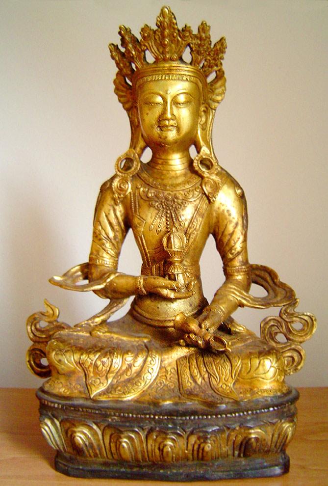 Vajrasattva holds the vajra