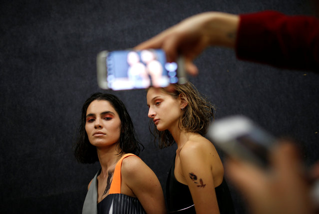 Models pose for picture backstage at the Tbilisi Fashion Week in Tbilisi, Georgia, October 21, 2016.