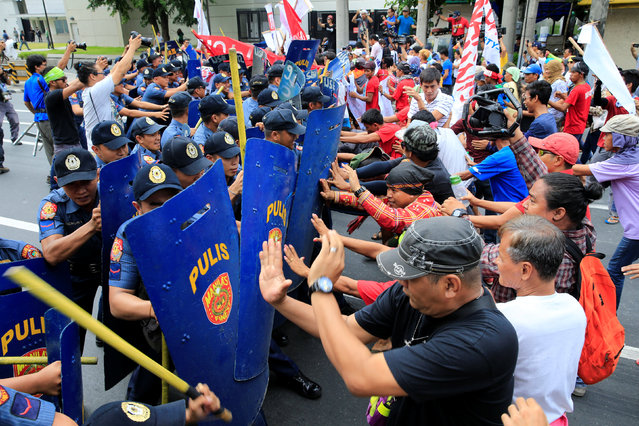 Various activist and Indigenous People's (IP) groups clash with anti-riot policemen during a pr