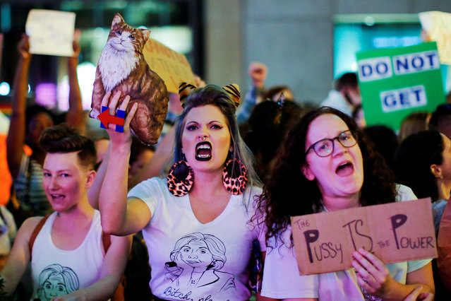 Women protest against Republican presidential nominee Donald Trump and the GOP in front of Trump Tow
