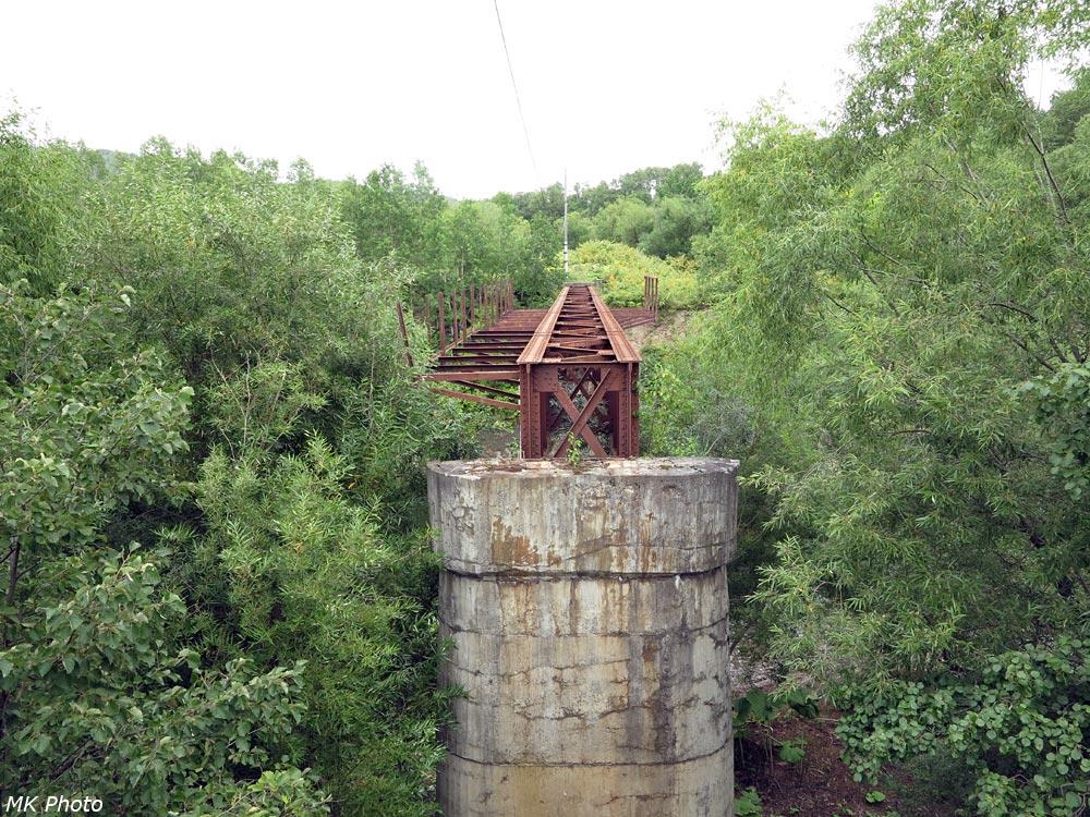 Разрушенный мост через р. Лютога