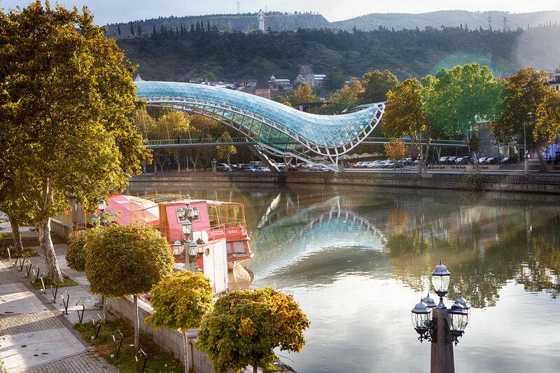Bridge of Peace in Tbilisi, Geaorgia, bow-shaped pedestrian bridge over the Kura River in Tbilisi, capital of Georgia. One of the most important sites of Tbilisi