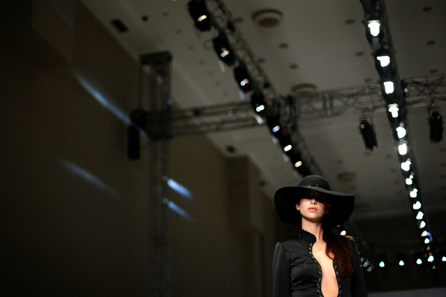 A model presents a creation by Greek designer Olga Karaververi during the 10th Athens Exclusive Fash