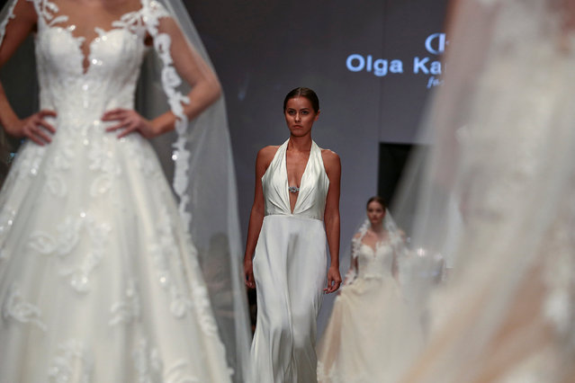 Models present creations by Greek designer Olga Karaververi during the 10th Athens Exclusive Fashion
