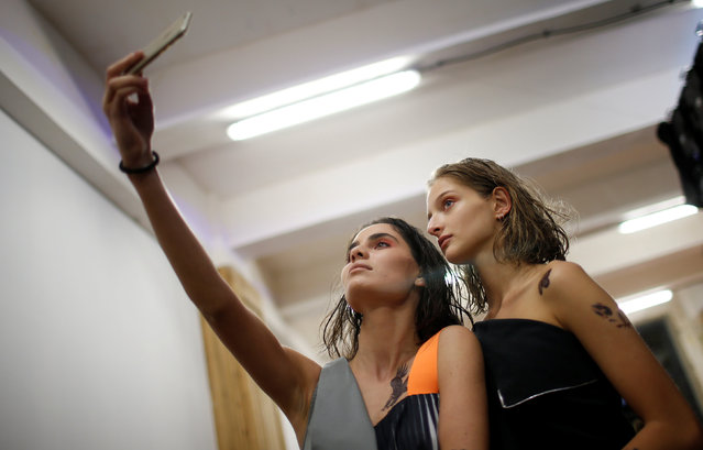 Models take selfie backstage at the Tbilisi Fashion Week in Tbilisi, Georgia, October 21, 2016. (Pho