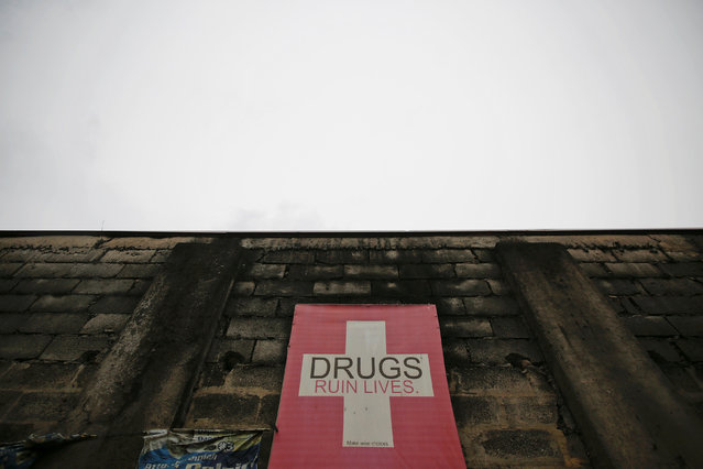 An anti-drug banner is displayed on a wall in Manila, Philippines October 15, 2016. (Photo by Damir