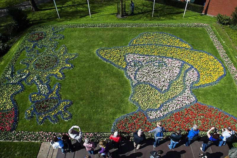 People look at a tulip portrait of Dutch painter Vincent van Gogh in Lisse, Netherlands.