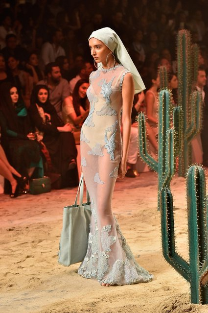A model walks the runway during the Amato show at Fashion Forward Spring/Summer 2017 held at the Dub