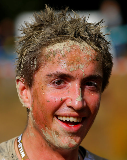 A competitors is seen after finishing the Wildsau Dirt Run (Wild Boar Dirt Run) obstacle course fun
