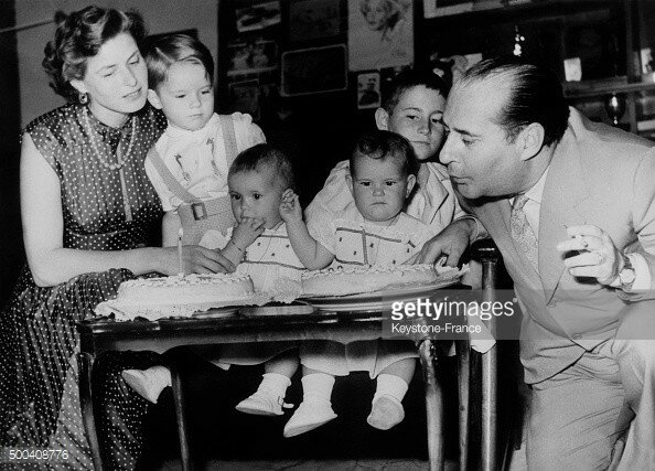 Ingrid Bergman and Roberto Rossellini celebrate the first birthday of their twin daughters Isabella and Isotta.jpg