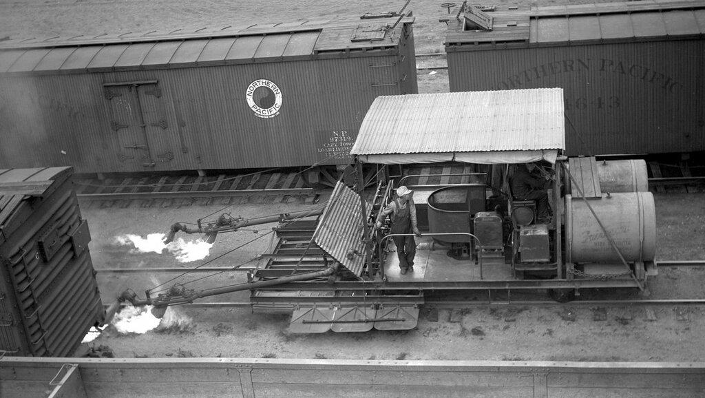 Northern Pacific weed burner moving slowly at Mandan, N.D., July 26, 1934.