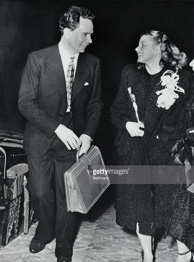 Ingrid Bergman holding her 'Oscar' is accompanied by her husband Dr. Peter Lindstrom.jpg