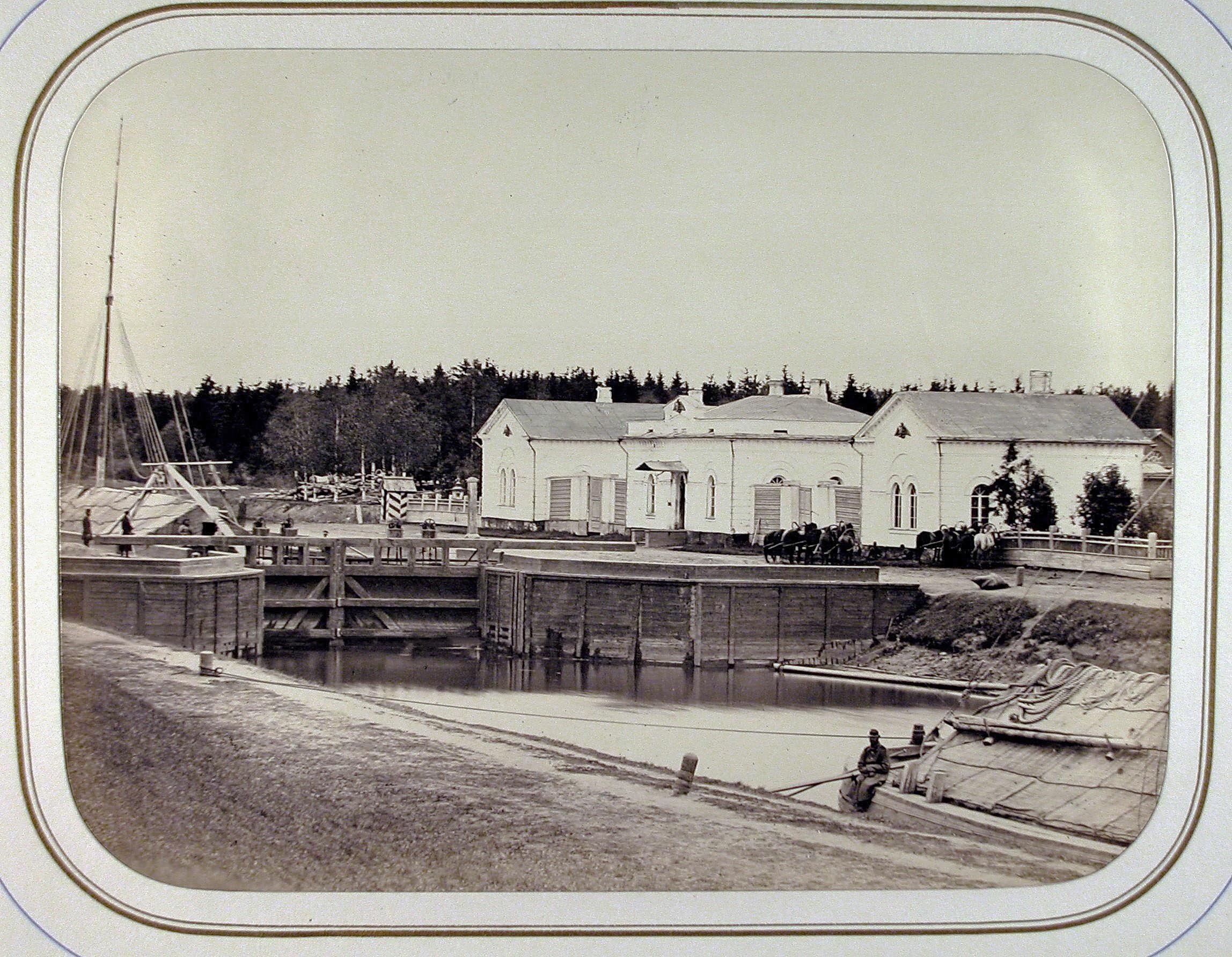 Вид домов у шлюза Безопасность на Белозерском канале.1865