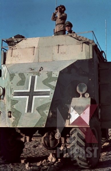 stock-photo-field-marshal-erwin-rommel-watching-battlefield-1941-tunisia-in-captured-british-armoured-truck-max-mammut-12496.jpg