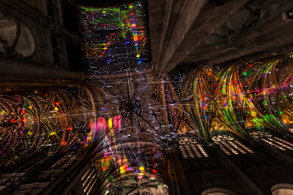 A Virtual Reality Sky Projected Above a Parisian Church by Artist Miguel Chevalier