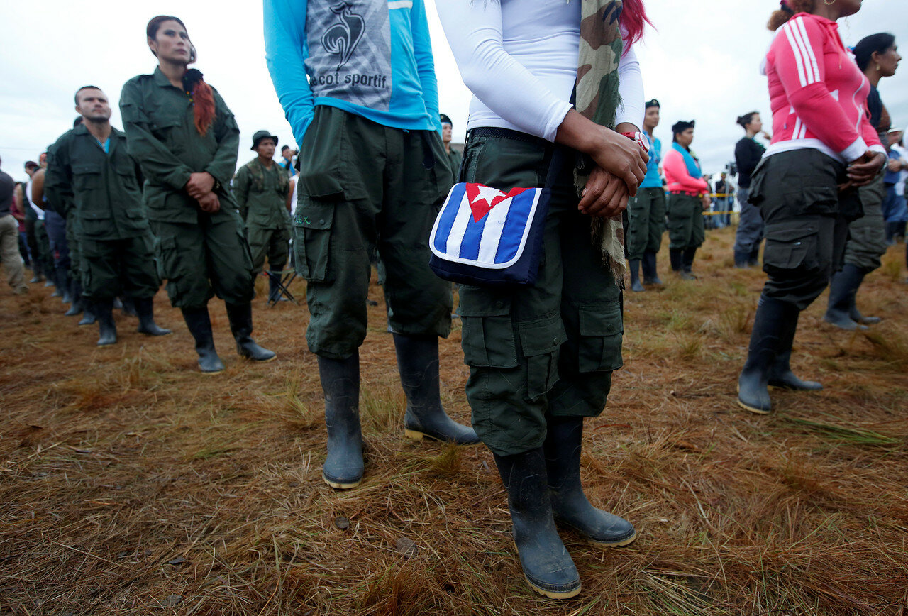 Fighters from FARC stand in line during opening of ceremony congress at the camp where they prepare for ratifying a peace deal with the government, near El Diamante in Yari Plains, Colombia