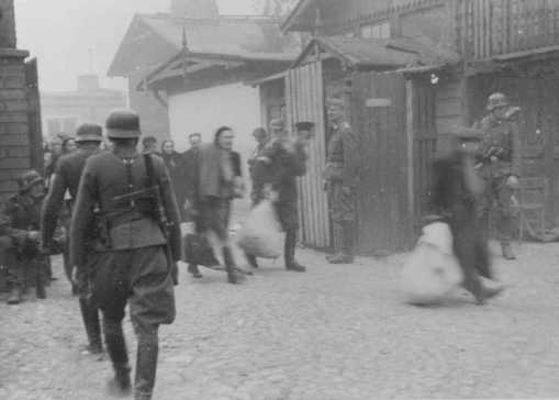 During the Warsaw ghetto uprising, German soldiers round up Jews in factories for deportation.jpg