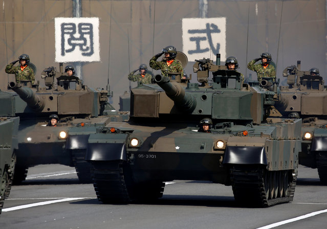 Japanese Self-Defence Forces' (SDF) tank units take part in the annual SDF ceremony at Asaka Ba