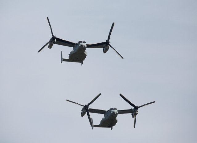 U.S. Osprey aircraft fly in the annual ceremony of Japan's Self-Defence Forces at Asaka Base, J